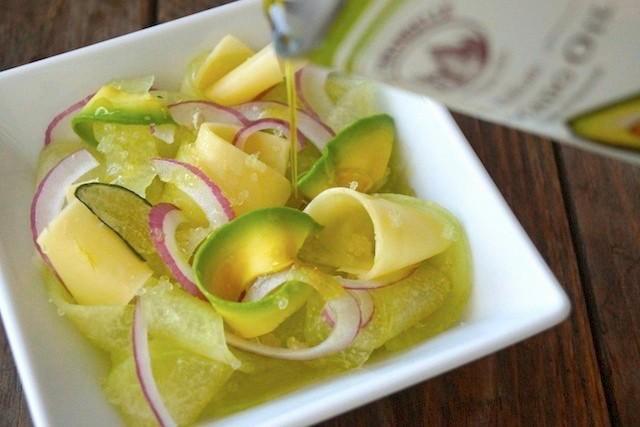 Melon Aocado Salad in a square white dish.