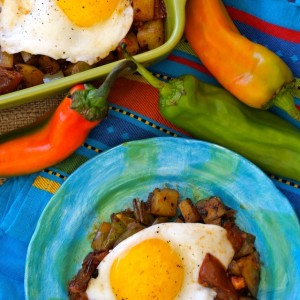 Hatch Chile Potato Hash and Eggs With Chipotle Roasted Tomatoes