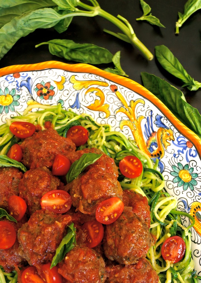 Zucchini Summer Spaghetti and Pesto Meatballs on a large, yellow-rimmed Italian platter with fresh basil.