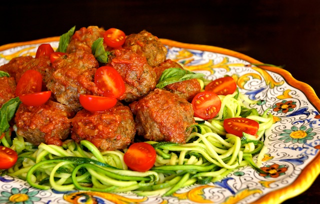 Zucchini Summer Spaghetti and Pesto Meatballs on a large, Italian, gold-rimmed platter.
