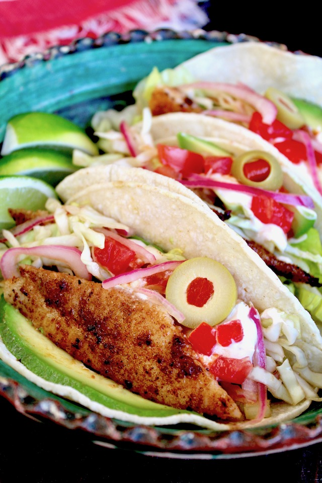 prepeared balckened fish tacos with spanish olive on top