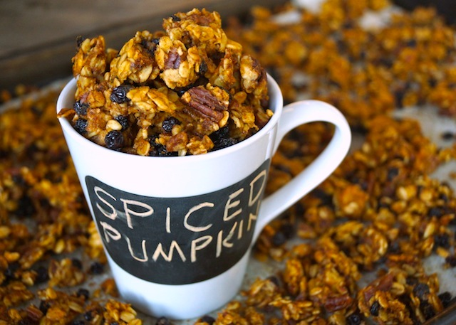 Spiced Pumpkin Double Roasted Granola in a white mug that says Spiced Pumpkin on it in a black box.