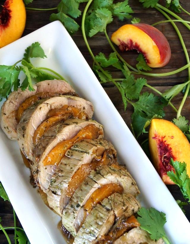 Peach Pork Tenderloin with Chimichurri on a long white plate