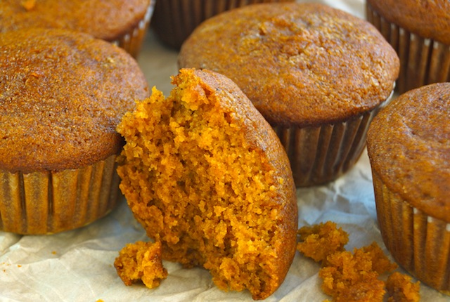 A few Pumpkin Pie-Olive Oil Muffins and one broken and crumbly one in front.