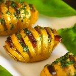 3 Bacon Basil Hasselback Dutch Yellow Potatoes on a white plate
