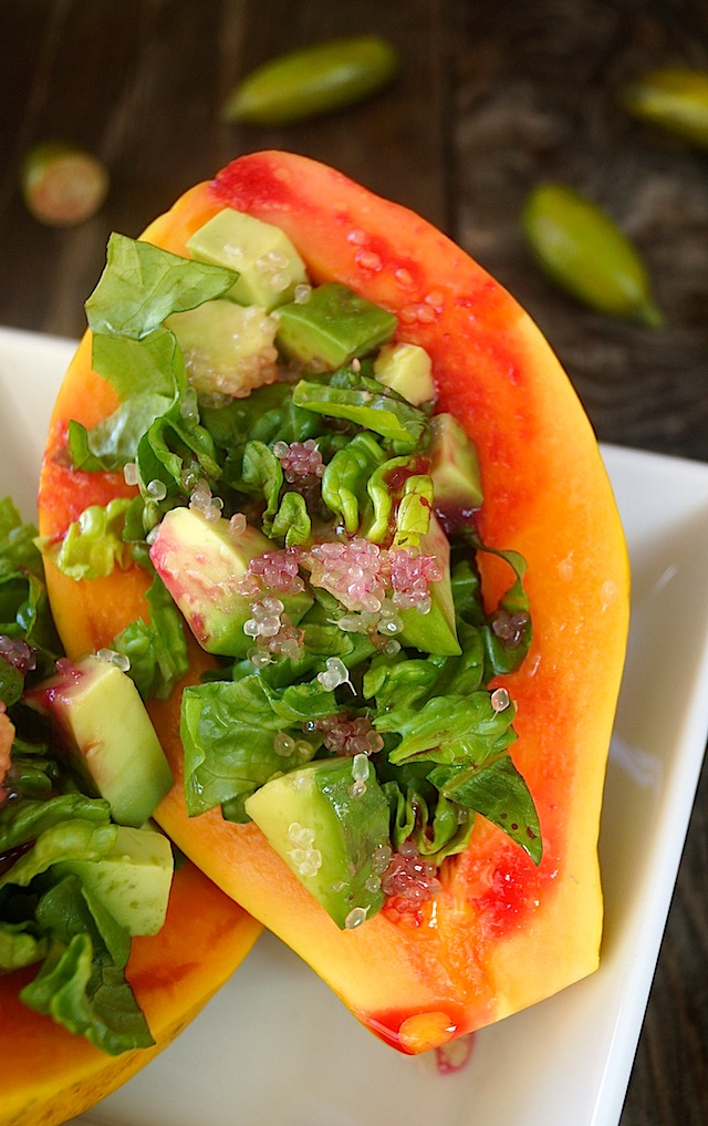 Papaya Avocado Salad with Cactus Pear Lemon Vinaigrette in a papaya half.
