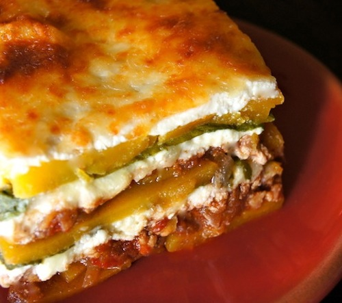 """slicWhat is a comfort food? This is one, a slice of Spiced Chicken-Butternut Squash """"Lasagna"""" on red plate"""