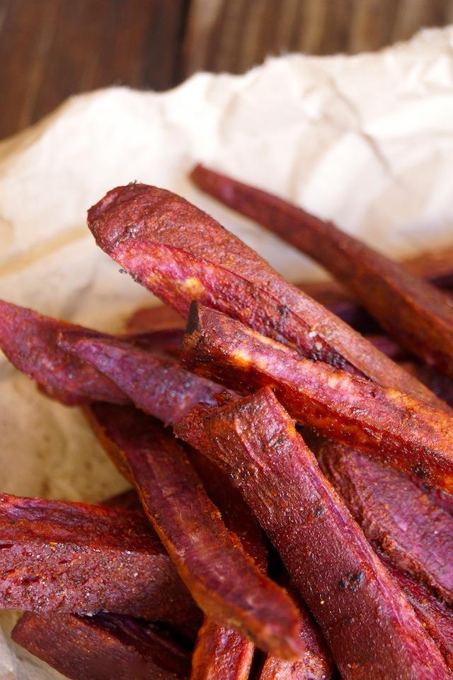 Chile-Lemon Roasted Purple Sweet Potato Fries in a plie on parchment