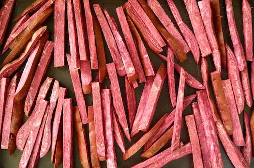 Roasted Purple Sweet Potatoes cut into sticks on sheet pan