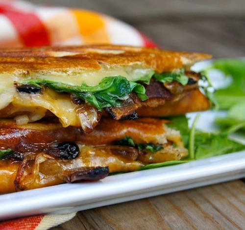 Dubliner Panini with Bacon-Blueberry Caramelized Onions on what plate