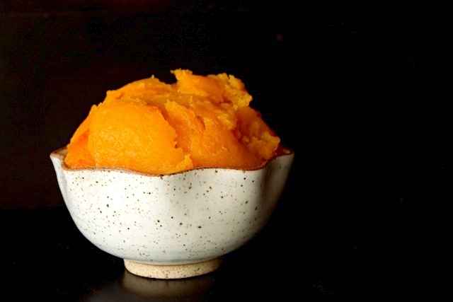 roasted butternut squash in a cream colored ceramic bowl