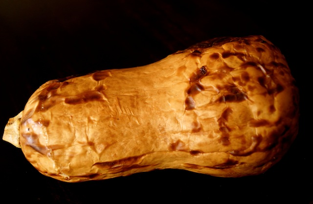 one whole roasted butternut squash, with charred skin