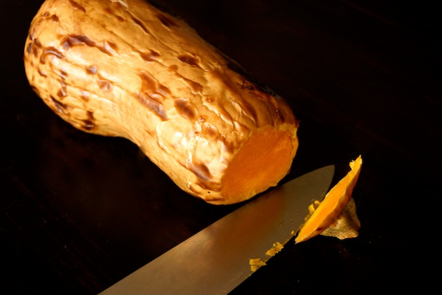 one whole roasted butternut squash, with charred skin and root end cut off