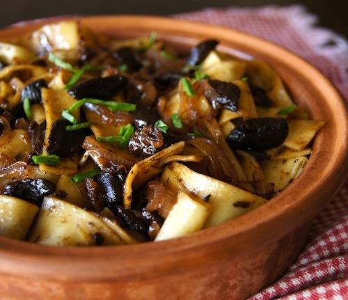 Black Garlic Pappardelle Pasta in terracotta bowl