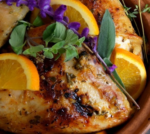 What is a comfort food? This is one, Herbs de Provence Orange Roasted Chicken with ornage slices and purple flowers