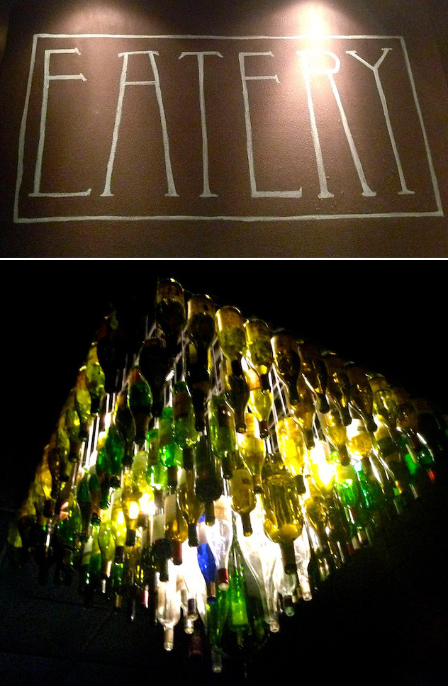 sign and light fixture made out of wine bottles at Claud & Co Eatery in Pasadena