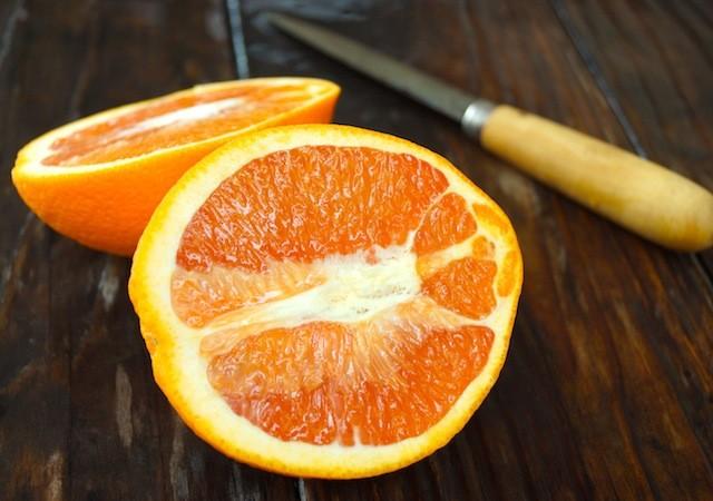 one cara cara orange sliced in half