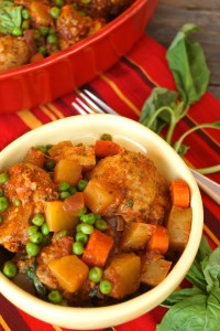 Stove-Top Spiced Turkey Meatball Stew - yellow - bowl- red - casserole pan - striped red tablecloth - basil leaves | COOKINGONTHEWEEKENDS.COM
