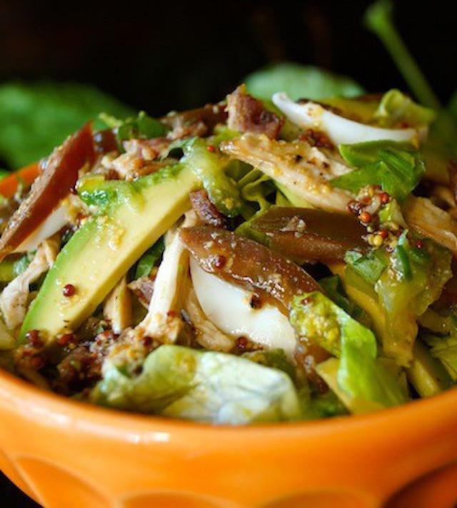 Close up of Shedded Chicken Cobb Salad in orange bowl