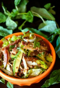 Shredded Chicken Cobb Salad with Citrus Vinaigrette-green-leaves-orange bowl-COOKINGONTHEWEEKENDS.COM
