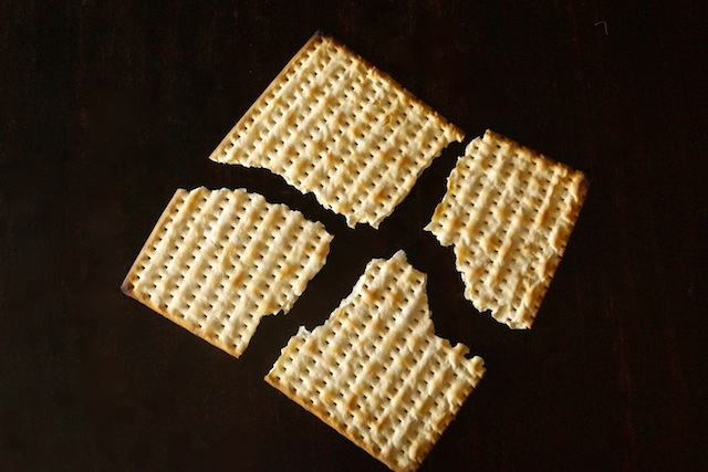 One matzo cracker broken into 4 pieces for Matzo Brei à la Florentine