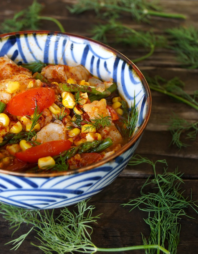 Summer Fish Stew in a blue and white bowl