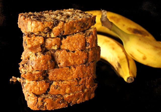 stack of Spiced Olive Oil Chocolate Chip Banana Bread with 3 bananas