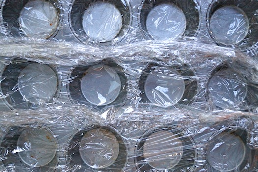 muffin tin with plastic wrap to make Individual-Coffee-Chocolate-Mud-Pies