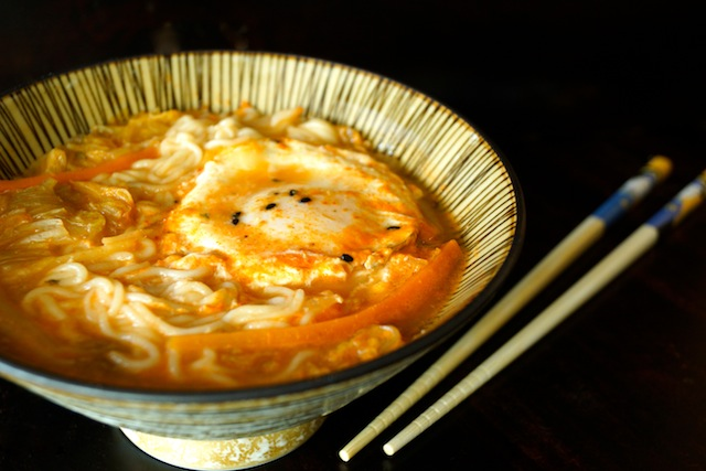 Kimchi Rame with egg in a bowl with chopsticks