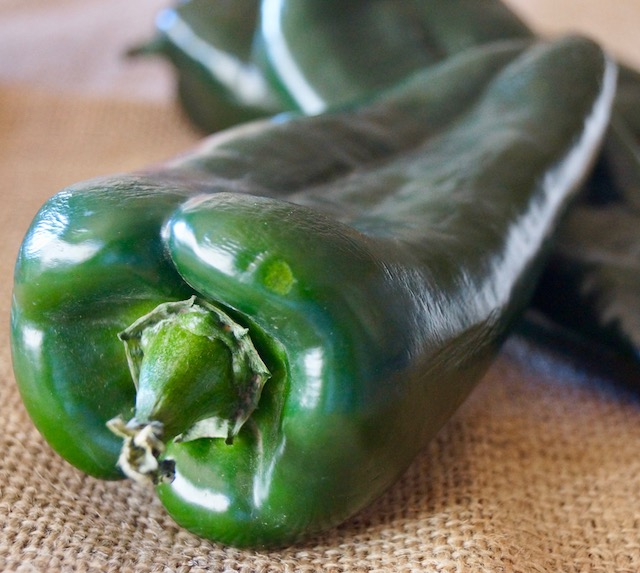poblano peppers on burlap surface
