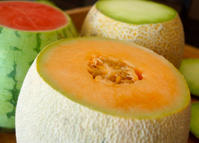 Close up of an orange melon with top cut off