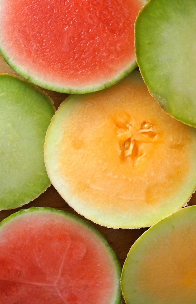Watermelon, orange and green melon slices