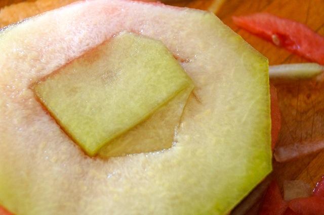 Fresh melon slices on cutting board