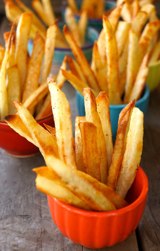 Oven Roasted French fries in small ceramic bowls, varying in color.