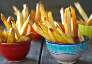 oven roasted fries in tiny red and blue bowls