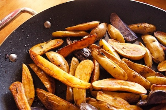 Wedges of Fingerling potatoes in a frying pan for French fries.