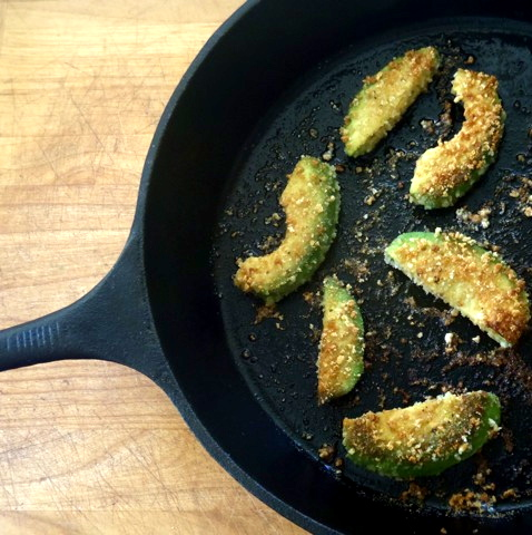 Avocado Fries in a cast iron skillet.