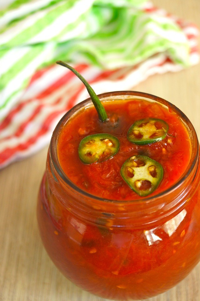 Sweet Tomato Preserves Recipe with Serranos in a small round jar