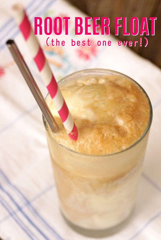 The Best Root Beer Float in a tall glass with a pink and white striped straw and silver spoon