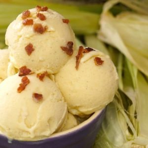 3 scoops of grilled corn ice cream in purple bowl