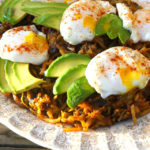 hash browns with poached eggs and avocado on top