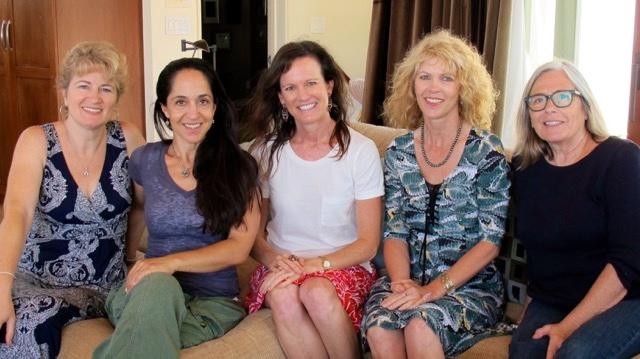 5 ladies sitting on sofa