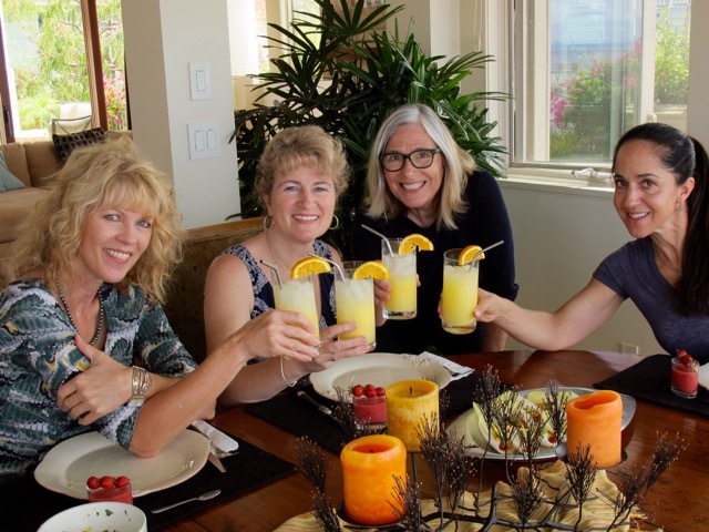 4 ladies at a table with a Summertme Garden Party Menu
