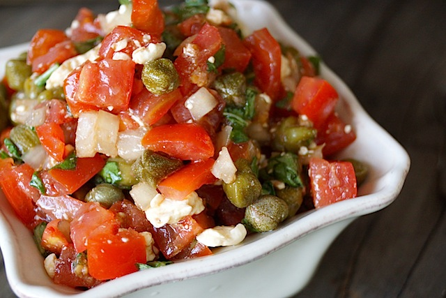 Close up of Tomato-Feta Salsa-Recipe for Meat or Chicken in a white, square dish.