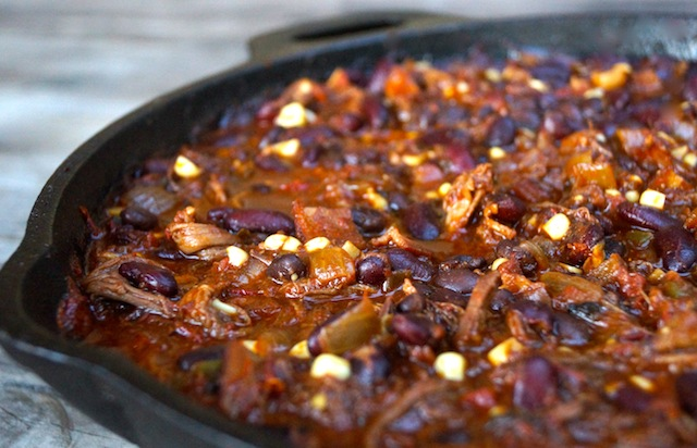 Chocolate-Chipotle Smoky Bacon Brisket Chili in a cast iron skillet