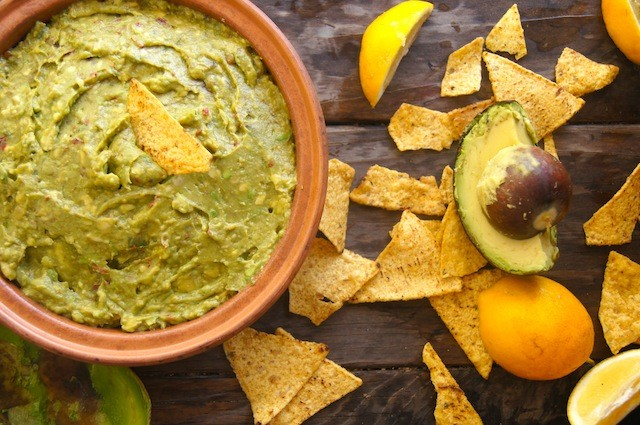 Chipotle-Lemon Guacamole in a round terra cotta dish