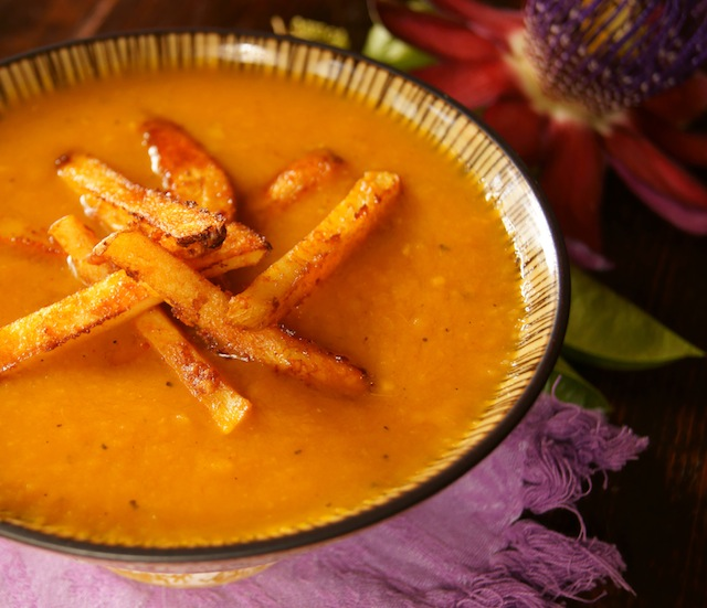 Roasted Pepepr French Fry Soup Recipe on a beige bowl on a purple cloth