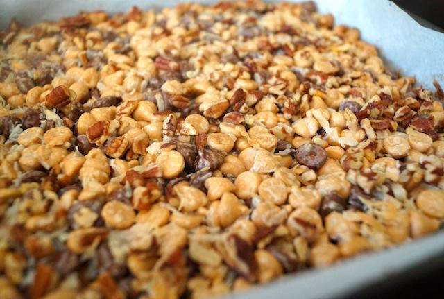 Peanut Butter Pretzel Seven Layer Magic bars, in one whole piece in square pan