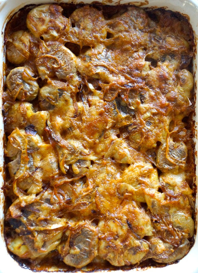 Smoky Spanish Smashed Potato Casserole -- These potatoes are deliciously rich, super creamy, and comforting beyond belief. This is the perfect fall side dish to go with braised meats, chicken or even a salad.