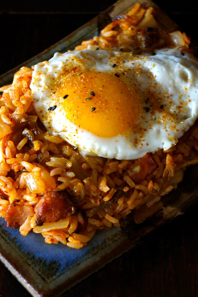 Kimchi-Bacon Fried Rice with an egg and black sesame seeds on top